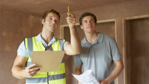 A home inspector reviewing a property with a client